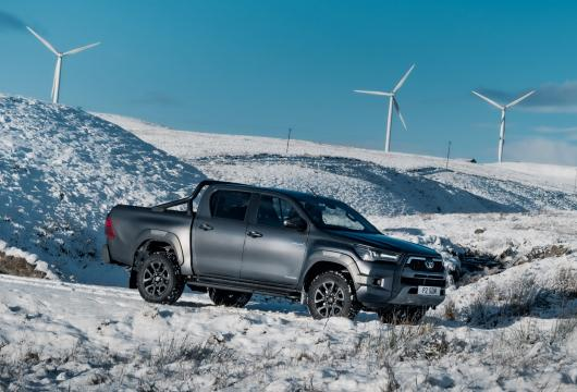 New Hilux in the snow with wind turbines in the background